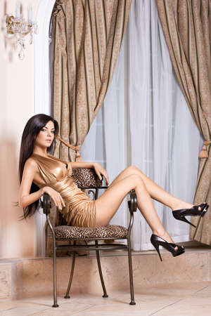 beautiful fashionable woman in the interior photo