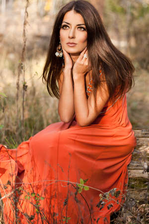 woman in orange dress at the nature photo