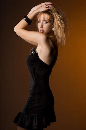 beautiful fashionable woman in black dress Stock Photo - 8426423