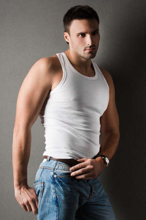 macho: young man in a t-shirt Stock Photo