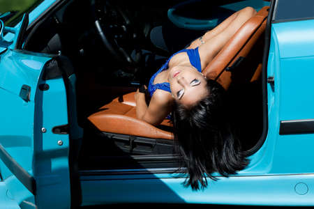 elegance fashion girls look sensuality young: Beautiful woman in a car