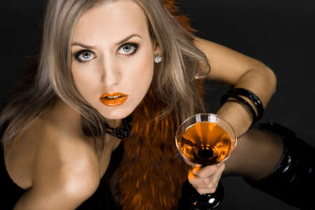 Beautiful woman with glass of cocktail photo