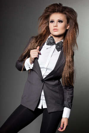 elegant fashionable woman with bow-tie photo