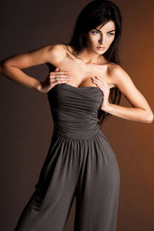 beautiful fashionable woman in grey clothes photo