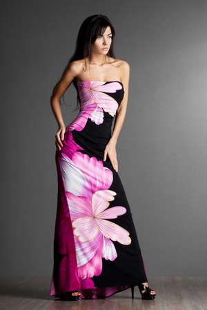 beautiful fashionable woman in pink dress photo