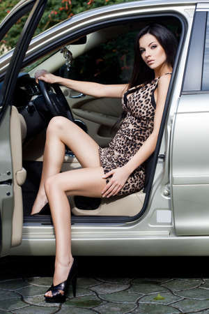 Beautiful woman at the car photo