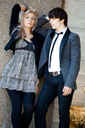 couple - girl and guy near the wall Stock Photo - 9017398