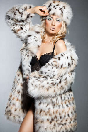 elegant fashionable woman in fur photo