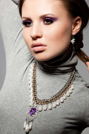 elegant fashionable woman with violet visage Stock Photo - 9110848