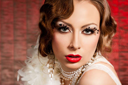 fashionable woman with art visage - burlesque photo