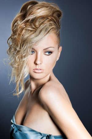 beautiful fashionable woman in a dress photo
