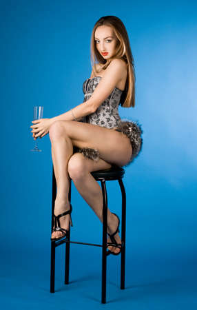 fashionable woman with glass of champagne photo