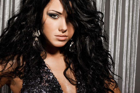 elegant fashionable woman with black hair photo