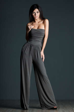 beautiful fashionable woman in grey clothes