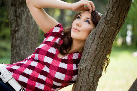 beautiful girl in a forest barrel Stock Photo - 9981684