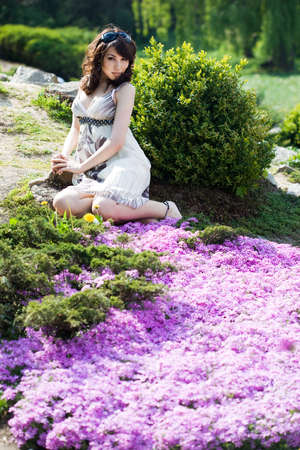 tender girl in the garden with flowers Stock Photo - 9981583