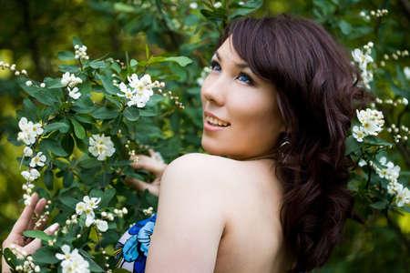 tender girl in the garden with flowerings trees Stock Photo - 9981475