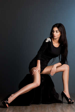 nude woman sexy: beautiful fashionable woman in black dress Stock Photo