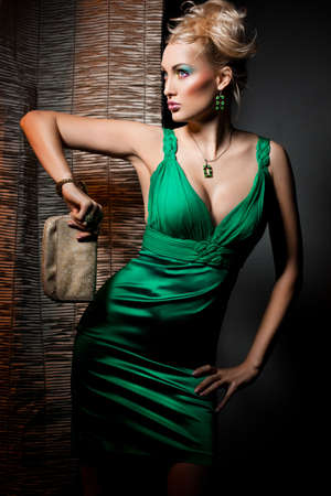 elegant fashionable woman in green dress
