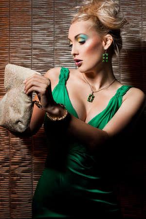 elegant fashionable woman in green dress photo