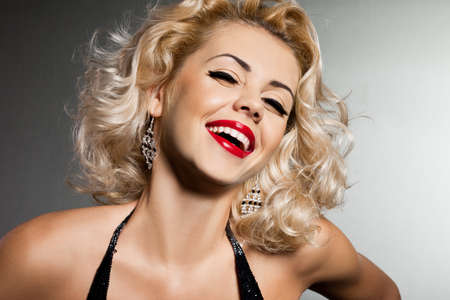 smiling blonde woman in black dress Stock Photo - 10823766
