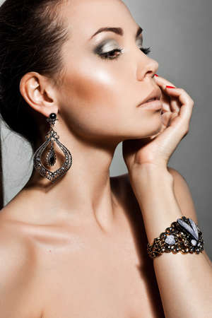 elegant fashionable woman with silver jewelry Stock Photo - 10823745