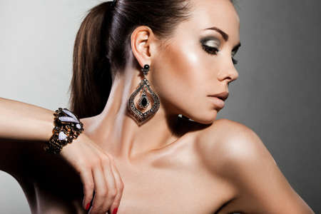 elegant fashionable woman with silver jewelry