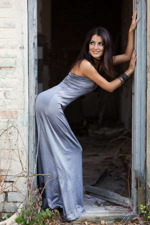 fashionable woman at the grunge door photo