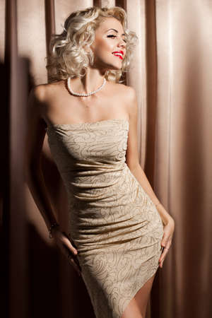elegance fashion girls look sensuality young: beautiful fashionable woman in beige clothes
