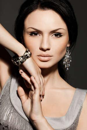 elegant fashionable woman with jewelry photo