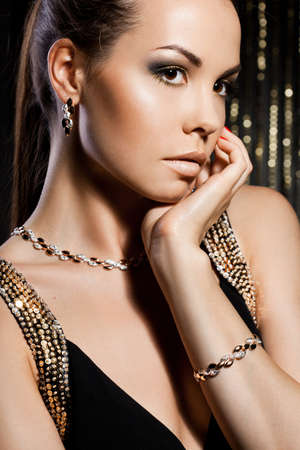 elegant fashionable woman with golden jewelry Stock Photo - 10966971