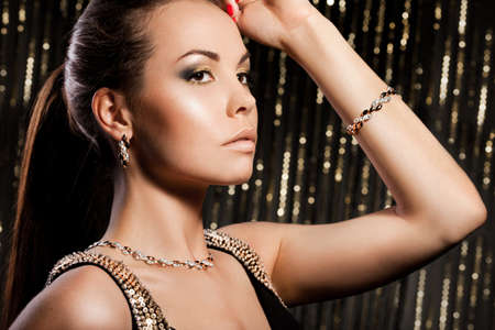 elegant fashionable woman with golden jewelry Stock Photo - 10966926