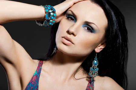 elegant fashionable woman with jewelry photo