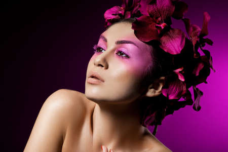 elegant fashionable woman with orchid photo