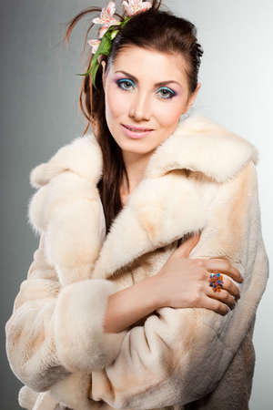 elegant fashionable woman in a fur coat photo