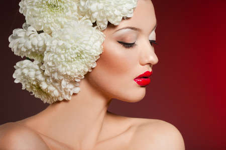 Portrait of the beautiful sweet woman with flowers photo