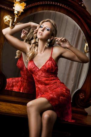 beautiful fashionable woman in interior  photo