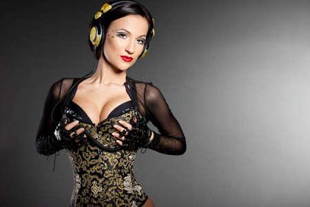 girl DJ listens music with headphones Stock Photo