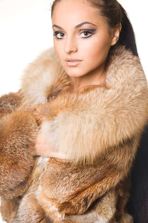 beautiful woman in a fur coat Stock Photo - 11455222
