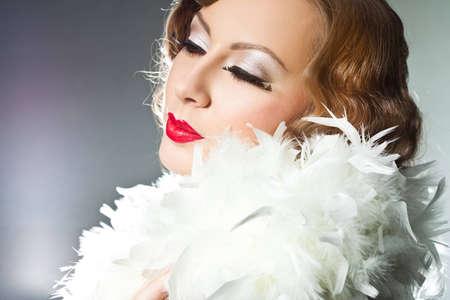 fashionable woman with art visage - burlesque photo