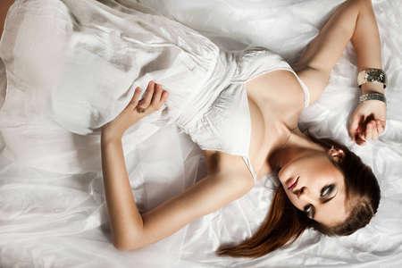elegant fashionable woman in white cloth photo