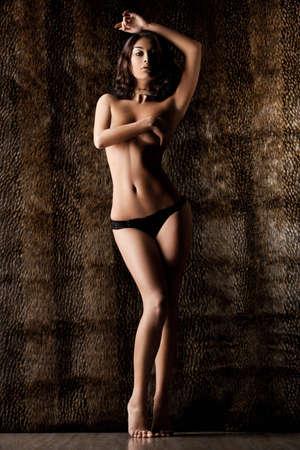 nude female body model: elegant fashionable woman on tigrine background