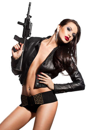 elegant fashionable woman with a gun in hands Stock Photo