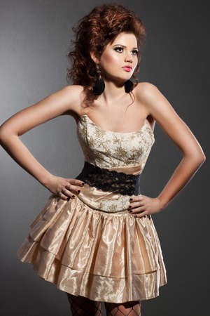 elegant fashionable woman in beautiful dress photo