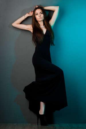 elegant fashionable woman in black dress photo