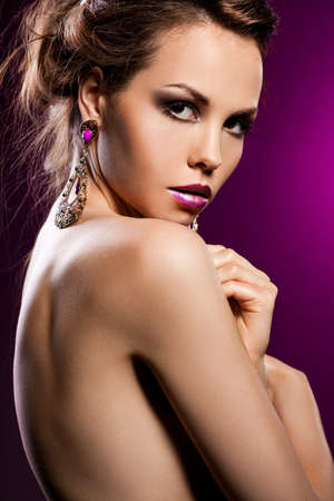 elegant fashionable woman with violet jewelry photo