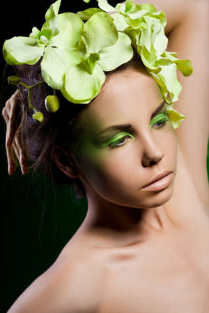 elegant fashionable woman with orchid Stock Photo - 12014975
