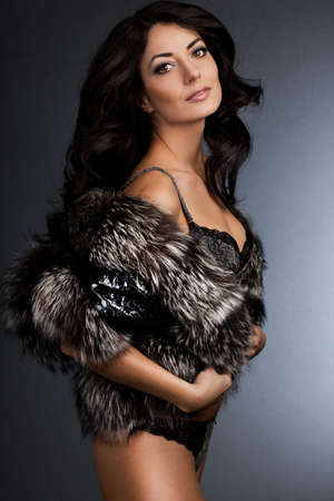 beautiful fashionable woman with fur photo