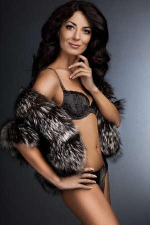 beautiful fashionable woman with fur photo