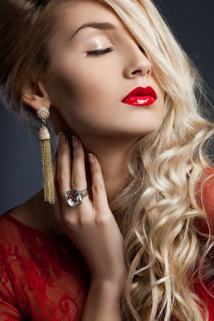 beautiful fashionable woman in red dress photo